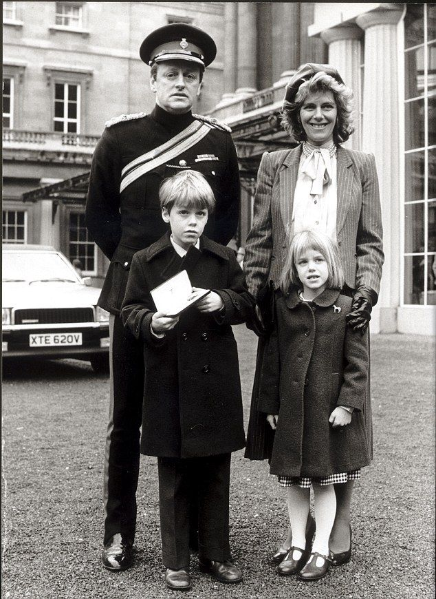 With Lt Col Andrew Parker Bowles, after he collected his OBE, alongside son Tom and daughter Laura in 1984
