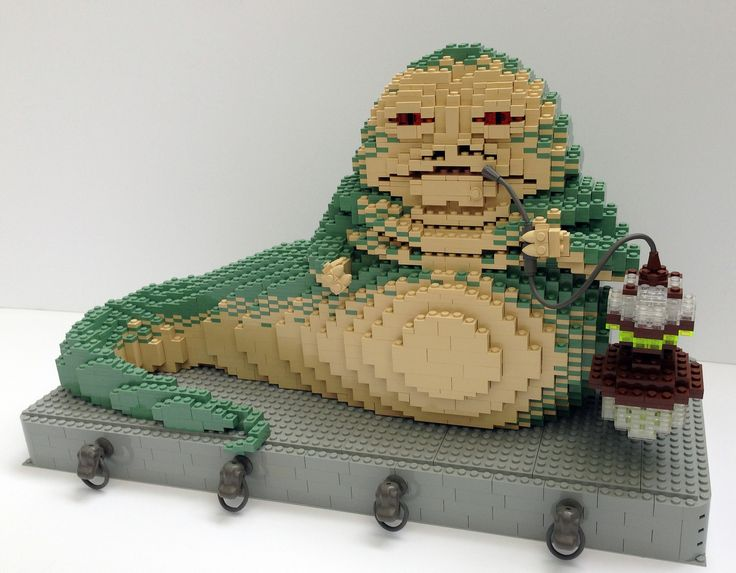https://flic.kr/p/uxM2rk | Jabba the Hutt | The vile intergalactic gangster Jabba the Hutt! I built this for the LEGOLAND Star Wars Days several years ago but never got around to photographing and uploading any pictures. Hey... better late than never! The decorative details on the platform are the Dinosaur heads from LEGO Studios set 1370 from Jurassic Park III.