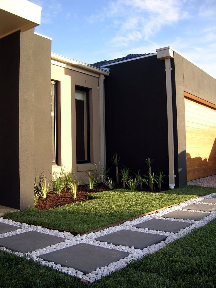 Modern Front Yard with Grasses, Pavers and Pebbles