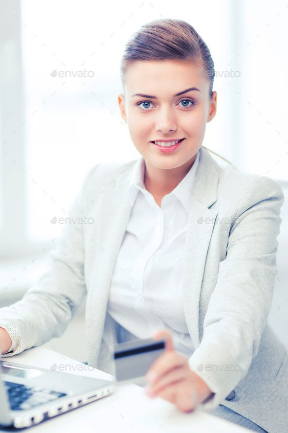 Businesswoman With Laptop Using Credit Card By Dolgachov Business