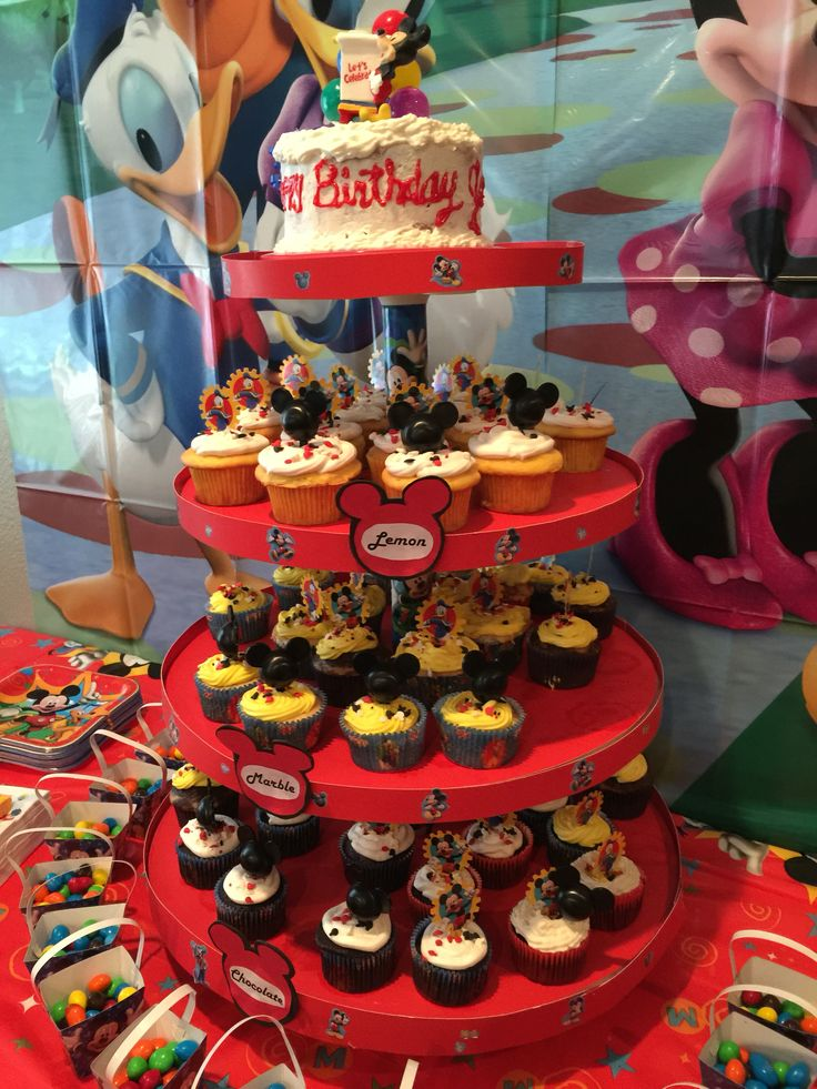 1st birthday cake stand with cupcakes