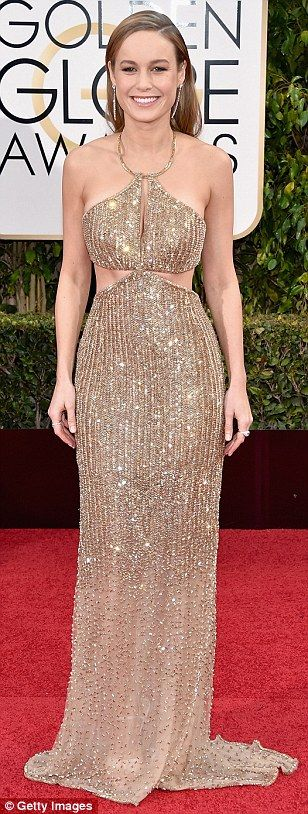 Brie Larson looks beautiful at The Golden Globes in her shimmering gold Calvin Klein Halterneck gown with cut out details #redcarpetstyle...x
