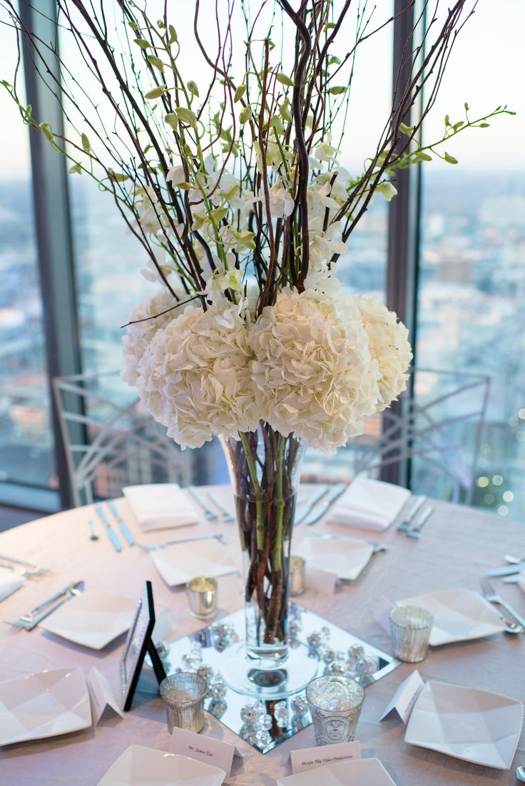 Tall wedding centerpiece with hydrangeas and orchids