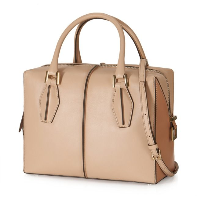 Tod's D-Cube small bowler bag crafted in exquisite, semi-glossy leather, with hand-dyed piping, rounded twin handles, detachable shoulder strap, zip fastening and leather slide.