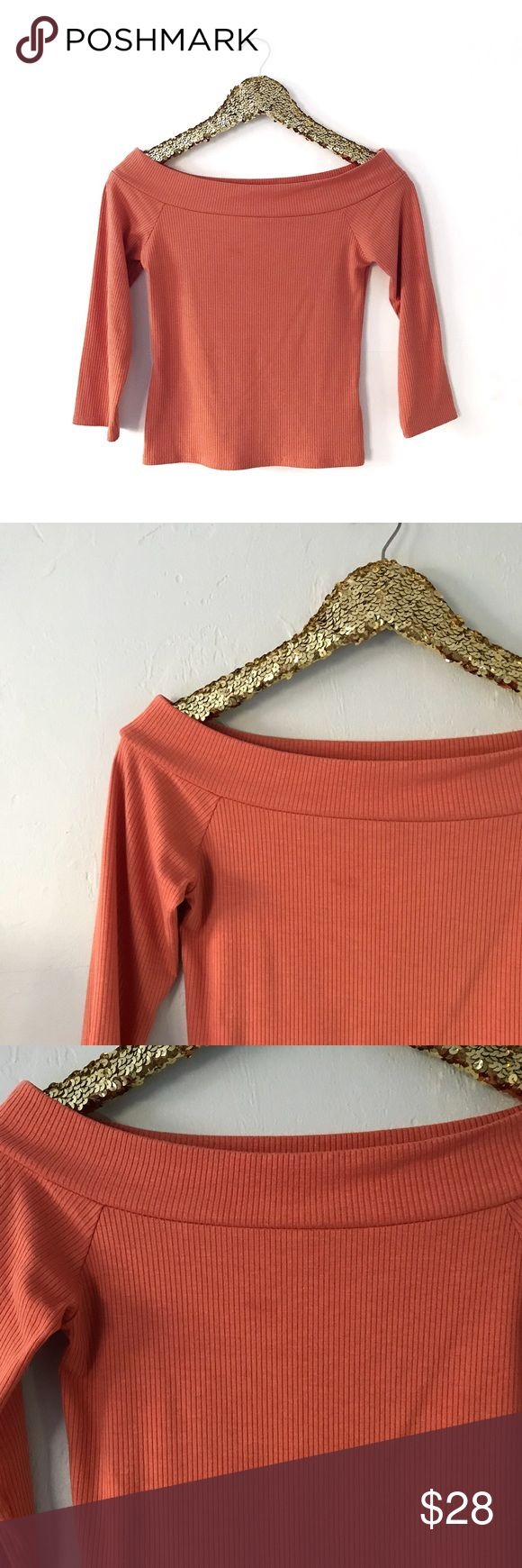 """Burnt Orange Ribbed Off the Shoulder Bardot Top Burnt Orange Ribbed Off the Shoulder Bardot Top  • Like New (Worn Once; if you look closely on the front there's something that looks like a barely noticeable stain, but I think it's just the way fabric is, it was like that when I purchased it) • From a Smoke Free & Pet Free Home  SIZE • M (may also fit S) • armpit to armpit approximately 14.5""""-15"""" + stretch • total length approximately 17.5""""  DETAILS - off shoulder/bardot neck - 3/4 sleeve…"""