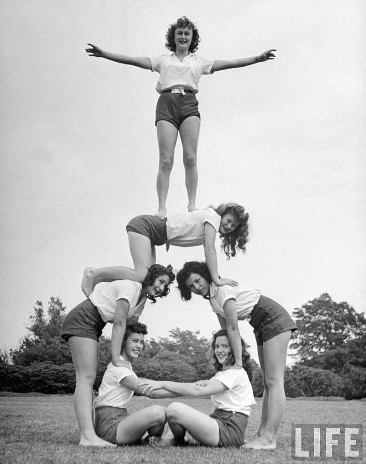 Group of teenage girls from Hoover High School doing a pyramid in gymnastics class. San Diego, 1946. By Martha Holmes