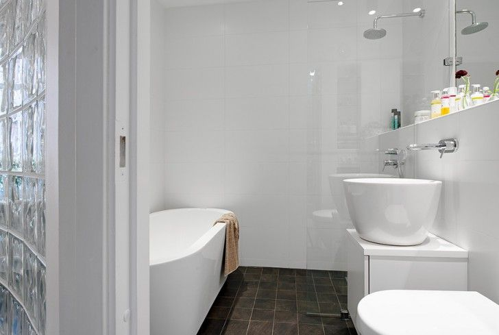 Apartment, White Bathtub Stainless Steel Shower Head Dark Brown Laminate Floor Toilet Seat Glass Partition Wall Faucet Mirror Wall Laminate Wall Flower Vase And Vessel Sink ~ Splendid Scandinavian Interior Design of Small Apartment and Terrace