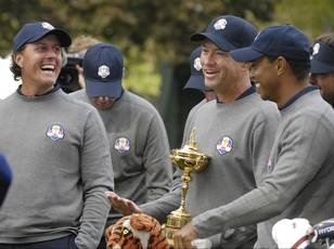 RYDER CUP TEAM USA - Team camaraderie is important in Ryder Cup competitions, and Phil Mickelson, U.S. captain Davis Love III and Tiger Woods shared a fun moment during team pictures Tuesday at Medinah.