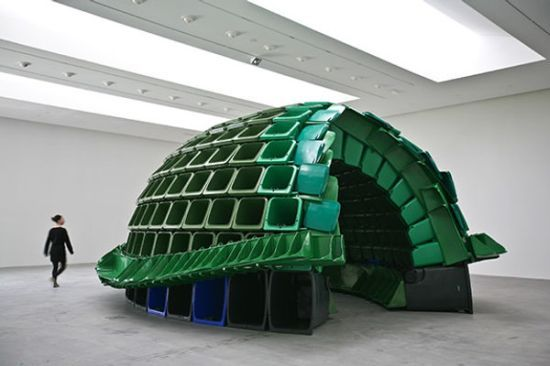 Canadian artist Brian Jungen created this impressive eco-art piece called Carapace, made from industrial trash and recycling bins. If you like this, be sure to check out his hanging mobile of animals made of luggage, 2008′s crux.