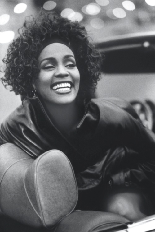 Whitney Houston rocking awesome hair and an awesomer smile.