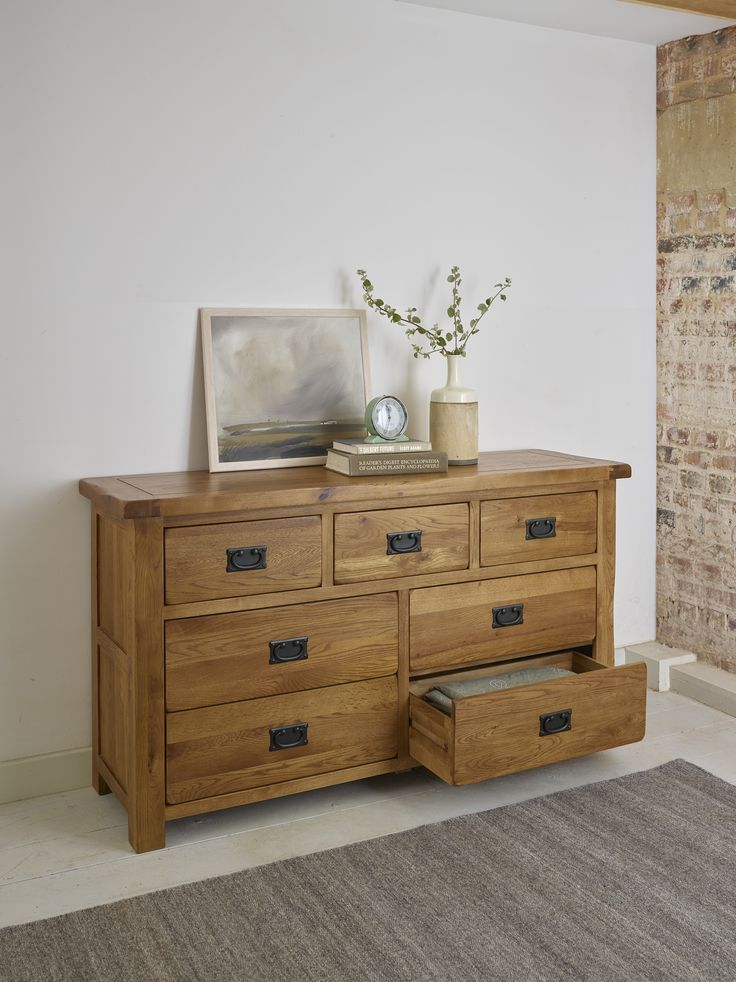 The Original Rustic Solid Oak 3+4 Chest of Drawers offers storage space galore with seven generously-sized drawers. Every drawer is solidly put together using resilient dovetail joints with solid oak backs, bases and runners. The rustic design is characterised by softly rounded corners, chamfered edges and beautiful bronze tinted drop bar handles