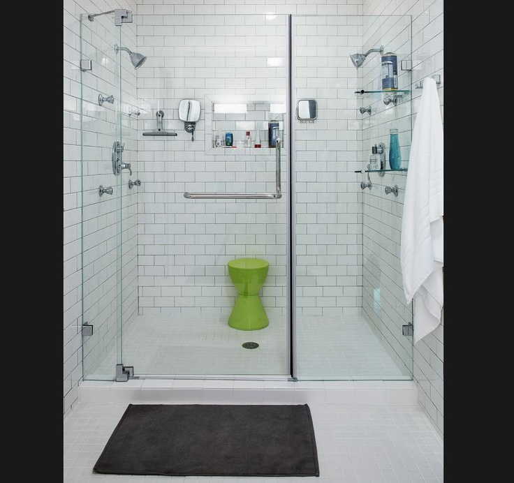 white subway tile bathroom modern with glass doors