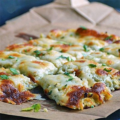 These Low Carb Breadsticks use a combination of cauliflower, garlic, Mozzarella and Parmesan cheese to make an awesome substitute for garlic bread.