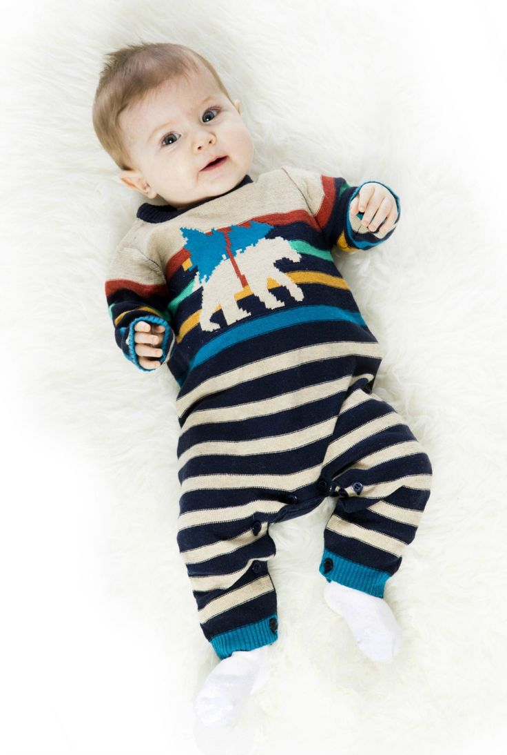 A bear and fir tree pattern adds a touch of unexpected charm to the Striped Knit Romper with Bear. This soft sweater knit romper features a long sleeve silhouette with multicolored horizontal stripes, a bear intarsia pattern on the chest, a button back, and button legs.
