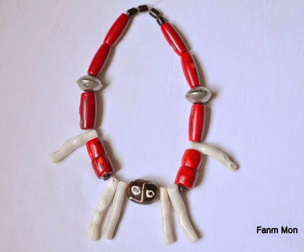 Natural coral tribal style necklace. Available at https://www.etsy.com/shop/FanmMon