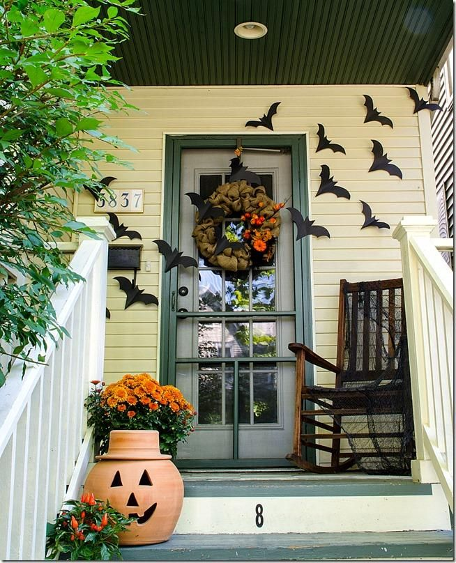 Halloween Decorations Front Porch  I love the bats and rocking chair because they imply movement.