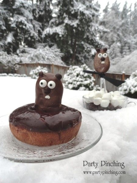 Groundhog's day treats: Nutter Butter bar covered in chocolate for ground hog, inside donut hole for his burrow.  Chocolate covered spoon ground hog in chocolate pudding burrow with marshmallow snow.