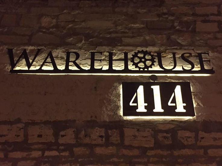 Business Sign with Logo. Outside mount on old brick facade. Backlit with LED lights.