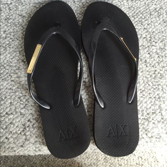 Armani Exchange Black Flip flops Only worn once or twice . Like new.. No signs of wear. The bottoms are pretty clean as well. The size says 5-6, but I'm a size 7 and they fit me. Armani Exchange Shoes Sandals