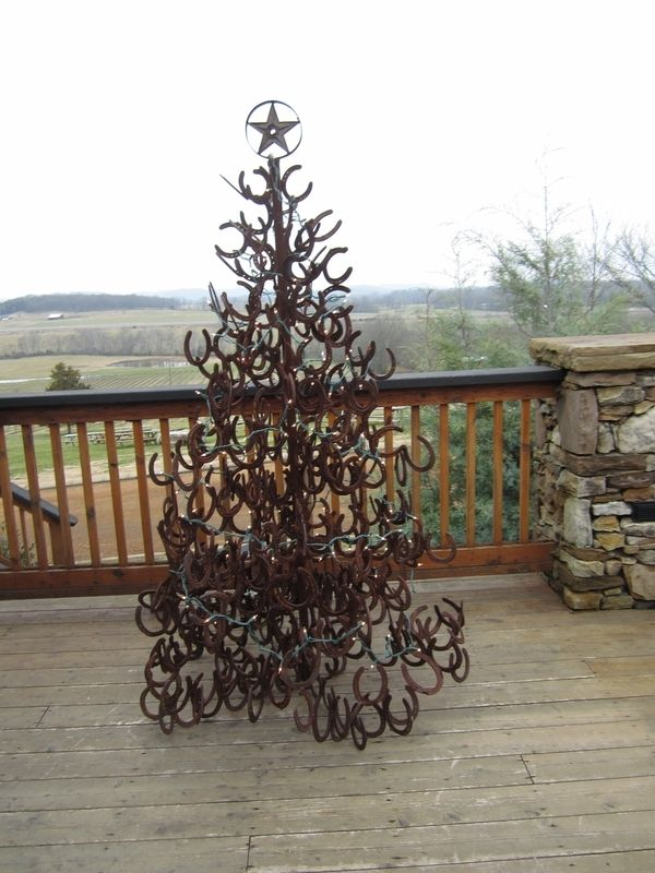 Horse shoe Christmas tree...that sure as heck wouldn't blow over in the wind!!!