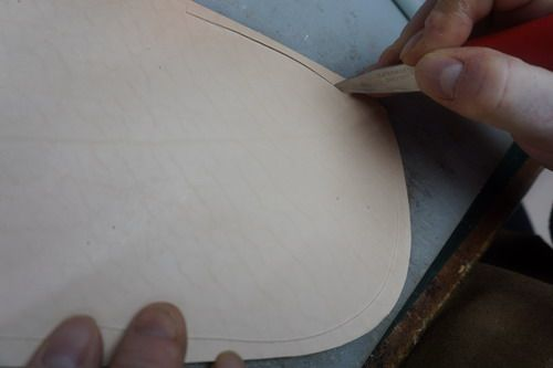 We start by cutting the pattern out on leather
