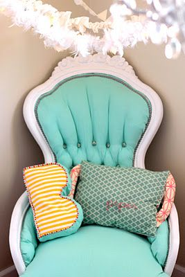 tutorial: how to reupholster a tufted chair. This looks exactly like the chair we've been needing to redo. I don't like these colors, but at least now we know how to do it.