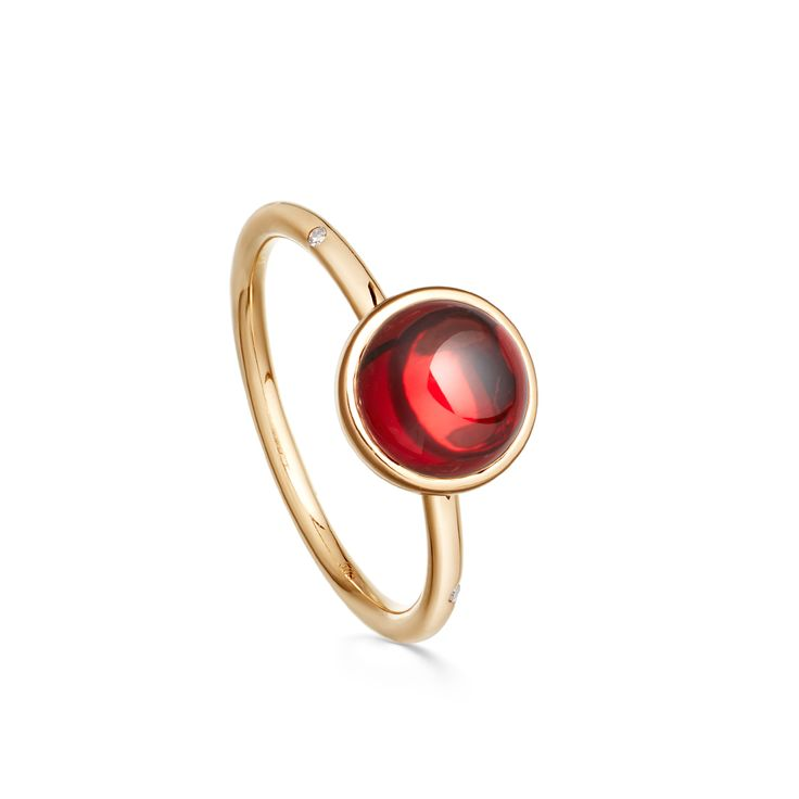 Mercury Garnet Ring.  Garnet cabochon in yellow gold with a white diamond set into the chain.