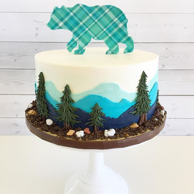 Welcome Baby Bear  I made this mountain scape design last year for a birthday cake then was asked again by the same clients to create it again for them, but this time for their baby shower!  #babybear #mountainscape #buttercreamcake