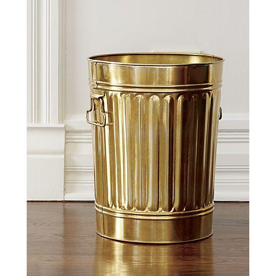 Glossy gold galvanized iron wastebin treats your trash like treasure. Classic, sturdy shape adds a clever wink to office, kitchen, bath.