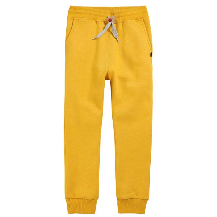 Yellow tracksuit pants made of fleece. Loose fit. Stretch ribbed knit waistband and ankle trims. Two side pockets and one patch back pocket. Drawstrings at the waistband. - 59,00 €