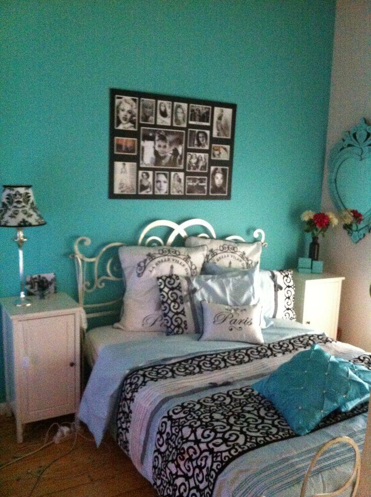 Tiffany blue wall, Paris themed sheets, venetian mirrors ...