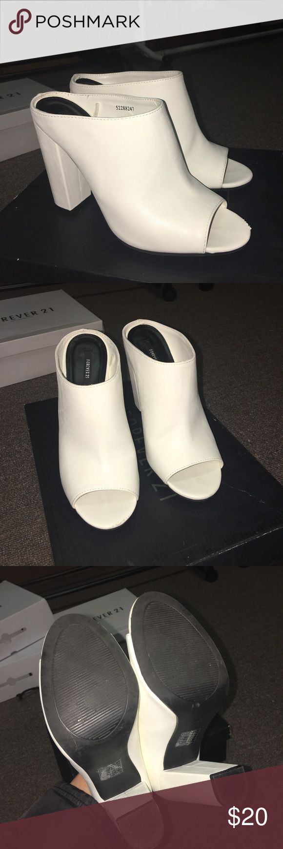 White Leather Mules White leather mules, staple piece for you shoe collection. Very small scrape in the front of one shoe, can be fixed with clear or white nail polish Shoes Mules & Clogs