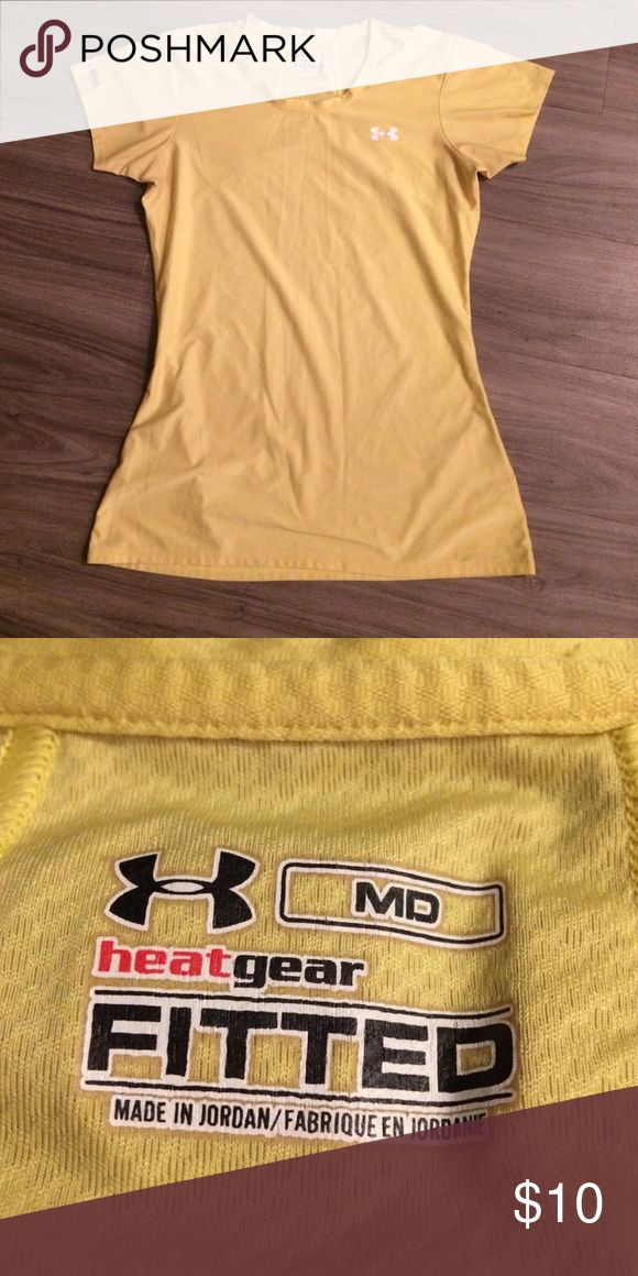 Under armor yellow shirt Not quite as vibrantly yellow as it use to be but still in great shape and very flattering/cute. Note that the top is heat gear fitted. Under Armour Tops Tees - Short Sleeve