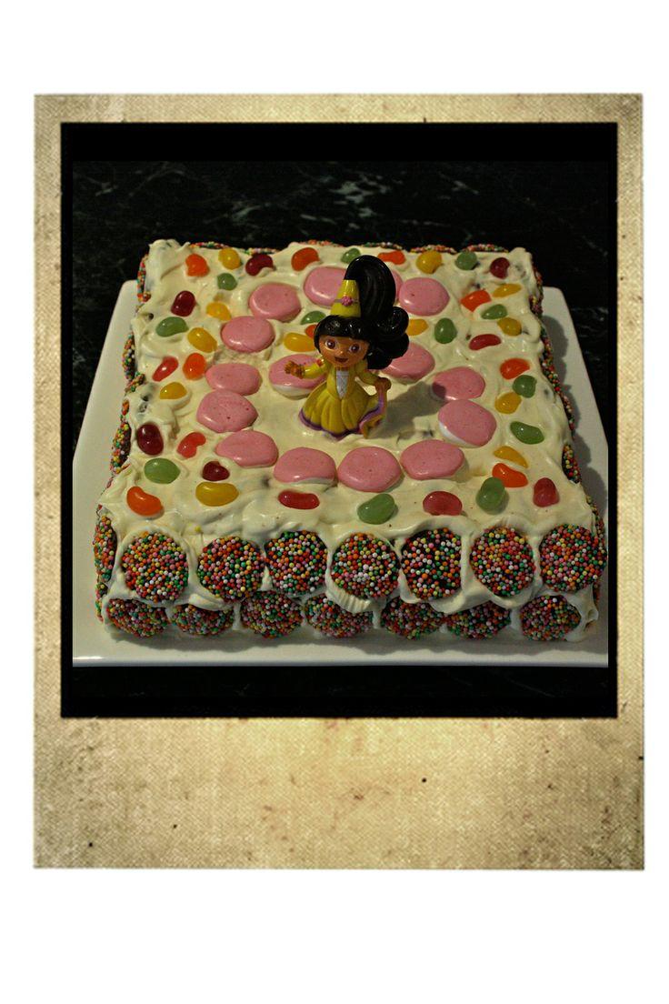 K's 6th birthday Dora cake.  Chocolate Ripple with cream, freckles, jelly beans, strawberry lollies and Dora figurine.