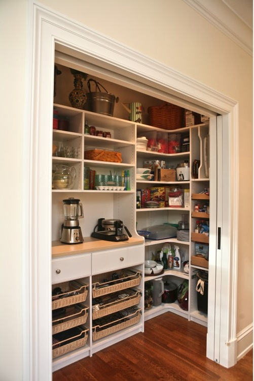 Sliding Door Leads Opens To Pantry.  It Would Be Easy To Convert A Closet To A Pantry Like This.