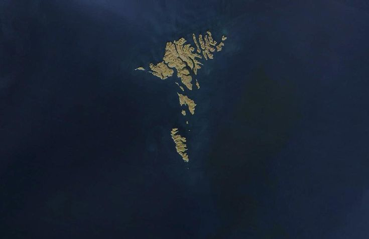 The Faroe Islands, as seen from orbit by NASA's Terra and Aqua satellites on April 17, 2003. The archipelago is about 80 km (50 mi) wide, and has a total area of approximately 1,400 sq km (540 sq mi).