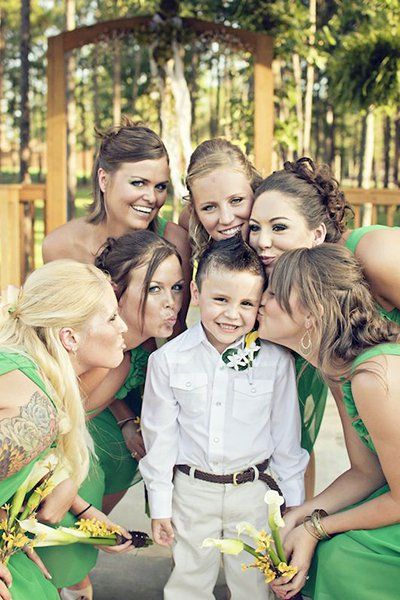 Encircled by adoring bridesmaids, this little fella has all the ladies wrapped around his little finger.Related: 50 Must-Have Photos With Your Bridesmaids