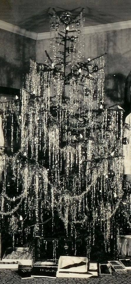 1940's Christmas tree.  This reminds me of my Dad's Christmas tree, he hung the tinsel one at a time and it had to be perfect!  Great memories.