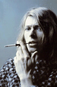 David Bowie long hair and cigarette