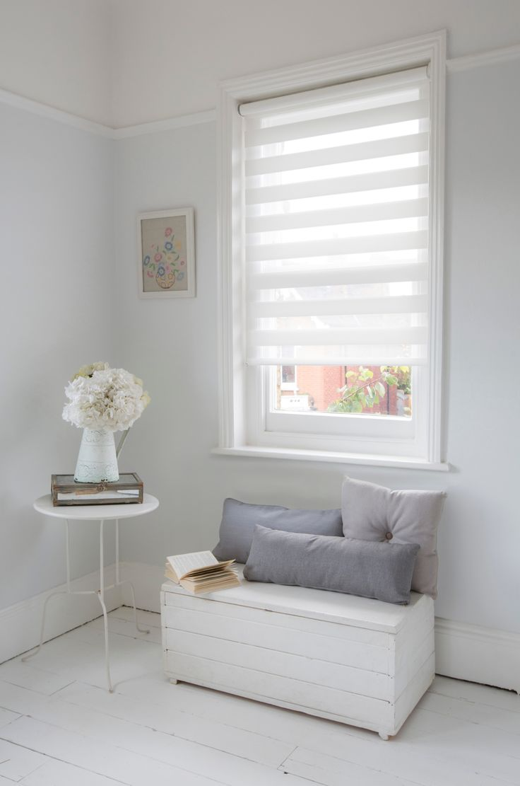 A cosy corner, with just the perfect amount of light for reading. Luxaflex® Twist® Roller Blinds providing privacy and just the right amount of light.