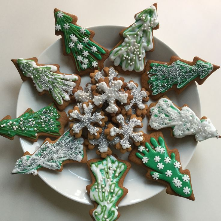 Gingerbread cookies I made, shaped like Christmas trees and snowflakes.