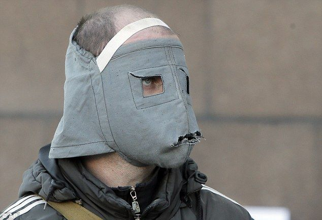 Home-made: A pro-Russian activist wears a mask today in front of the local government building in Donetsk, which continued to be barricaded despite Ukrainian special forces flushing out activists in a nearby city
