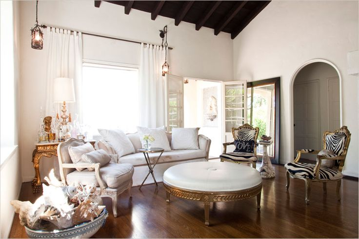 Love the white, the zebra chairs, the huge mirror, the ceilings...