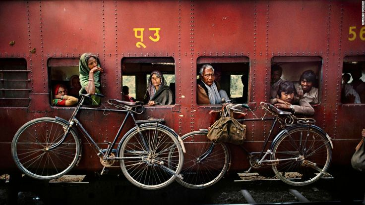 McCurry's remarkable photojournalism career began more than three decades ago, when he crossed the Pakistan border into Afghanistan disguised in native clothes.<br /><br />He returned with rolls of film sewn onto the inside of his garb, and later won the prestigious Robert Capa Gold Medal for his work. <br /><br />This image shows bicylcles hanging from the side of a passing train in West Bengal, 1983.<br />