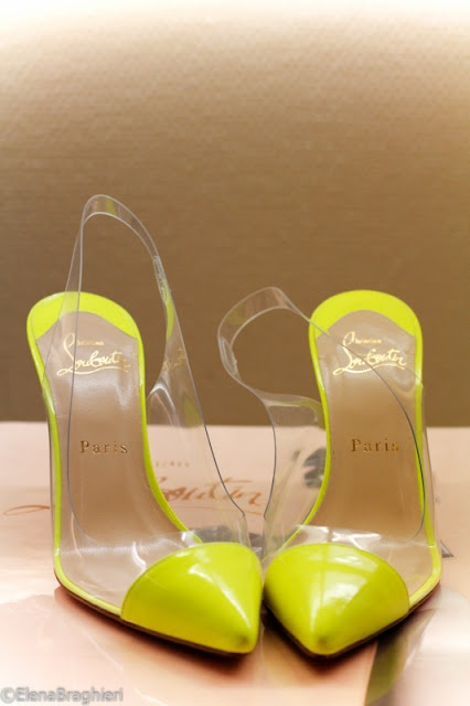 Plastic and neon yellow Louboutin pumps.