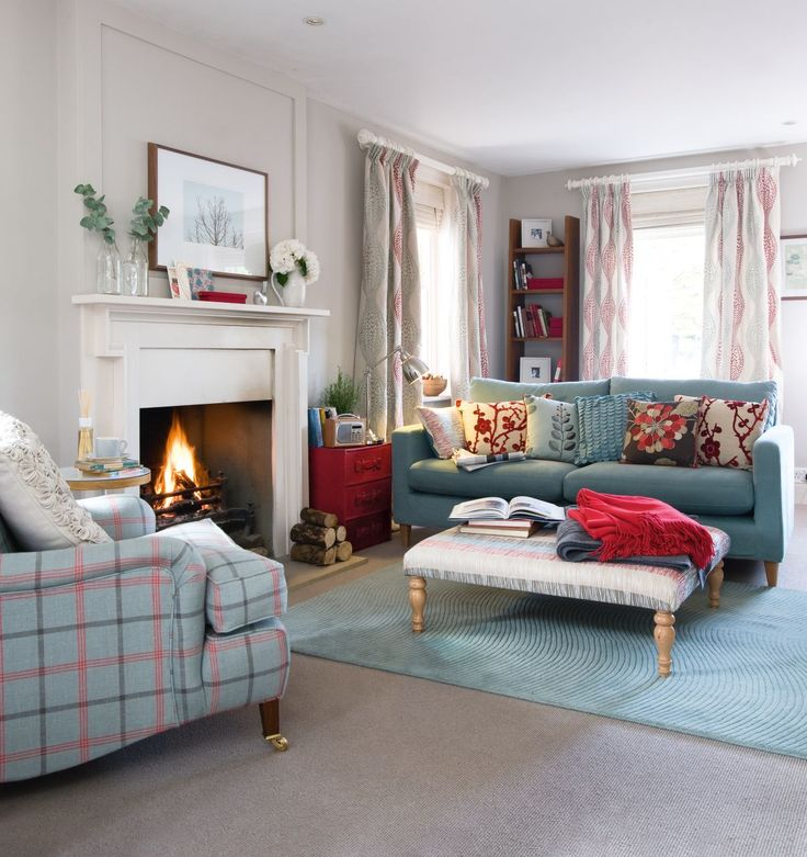 Update a neutral colour palette with shades of cherry red and teal and use classic plaid fabrics to create a living room with a country feel. Photography: Oliver Gordon. Find more living room ideas at housebeautiful.co.uk