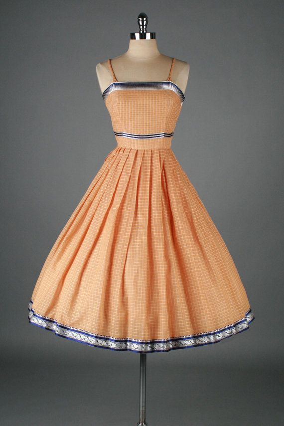 Spring is upon us and I'm feeling the 50s vibe... Including this little peach number
