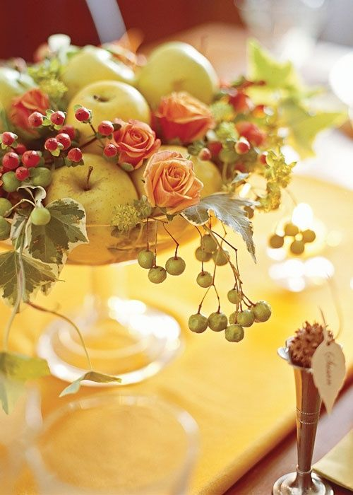 A pretty Fall arrangement of apples, berries and peach colored rose buds!