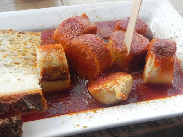 """Currywurst: Germany is famous for """"Wurst"""": spicy pork sausage, available in a variety of types, since each region has its own version of this snack. Currywurst is a sausage cut into pieces, covered with spicy ketchup and is usually served with bread and fries."""