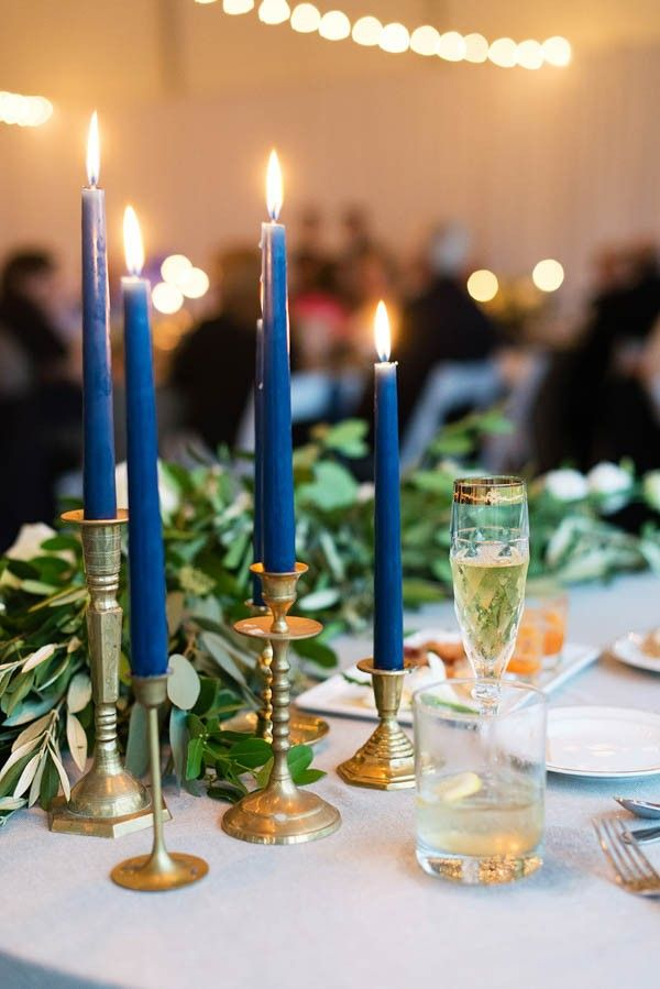 Vintage gold candlesticks with navy candles. M2 Photography | mysweetengagement.com